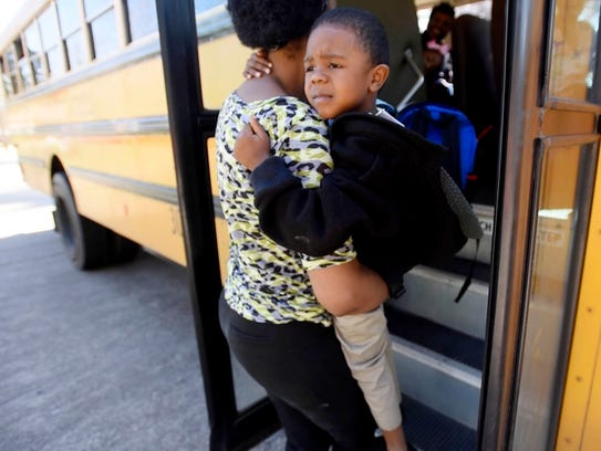 Tileda Dunn greats her son Rajon Dunn at the bus when