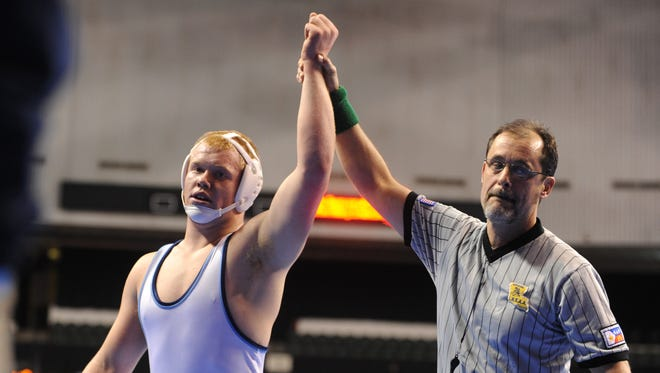 Airline's Dalton Elliott won a Division I match in the 215-pound wight class during the 2011 wrestling championships in Bossier City. The state tournament returns this weekend to the CenturyLink Center.