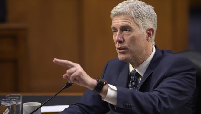 Supreme Court Justice nominee Neil Gorsuch testifies Wednesday on Capitol Hill in Washington during his confirmation hearing before the Senate Judiciary Committee.