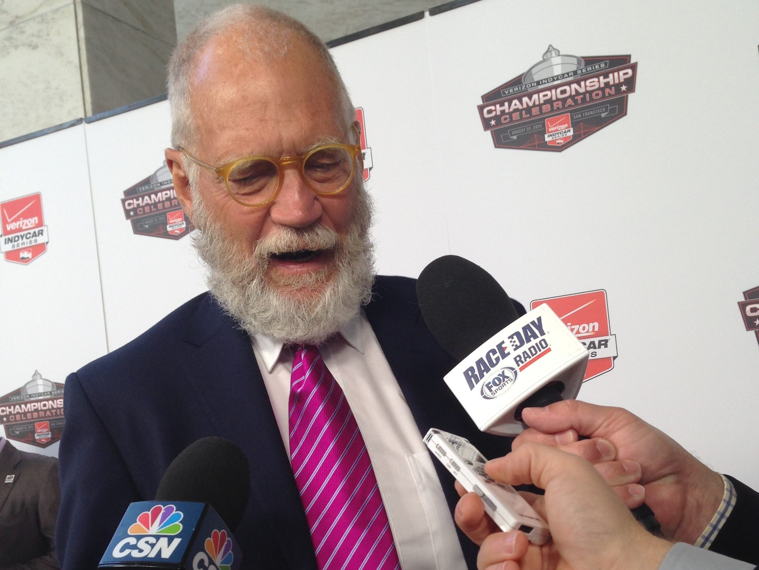 David Letterman talks with the media at the IndyCar finale Sunday, Aug. 30, 2015, at Sonoma, Calif.