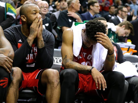 Raptors guard DeMar DeRozan (right) and another player look dejected as the Bucks close out their 104-77 victory over Toronto in Game 3 of their first-round playoff series.