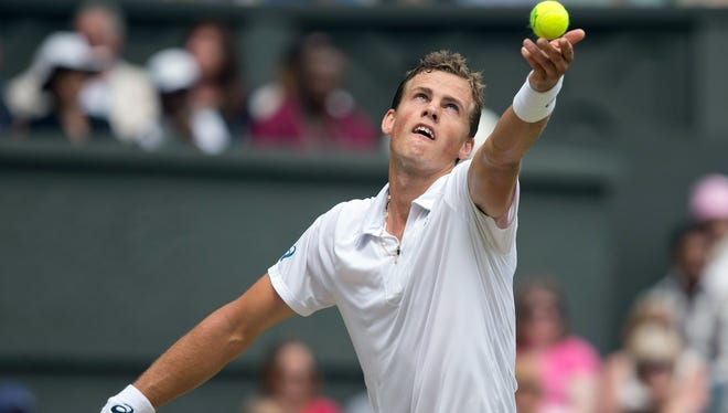 Vasek Pospisil (CAN) in action during his match against Andy Murray (GBR) on day nine of The Championships Wimbledon at the AELTC.