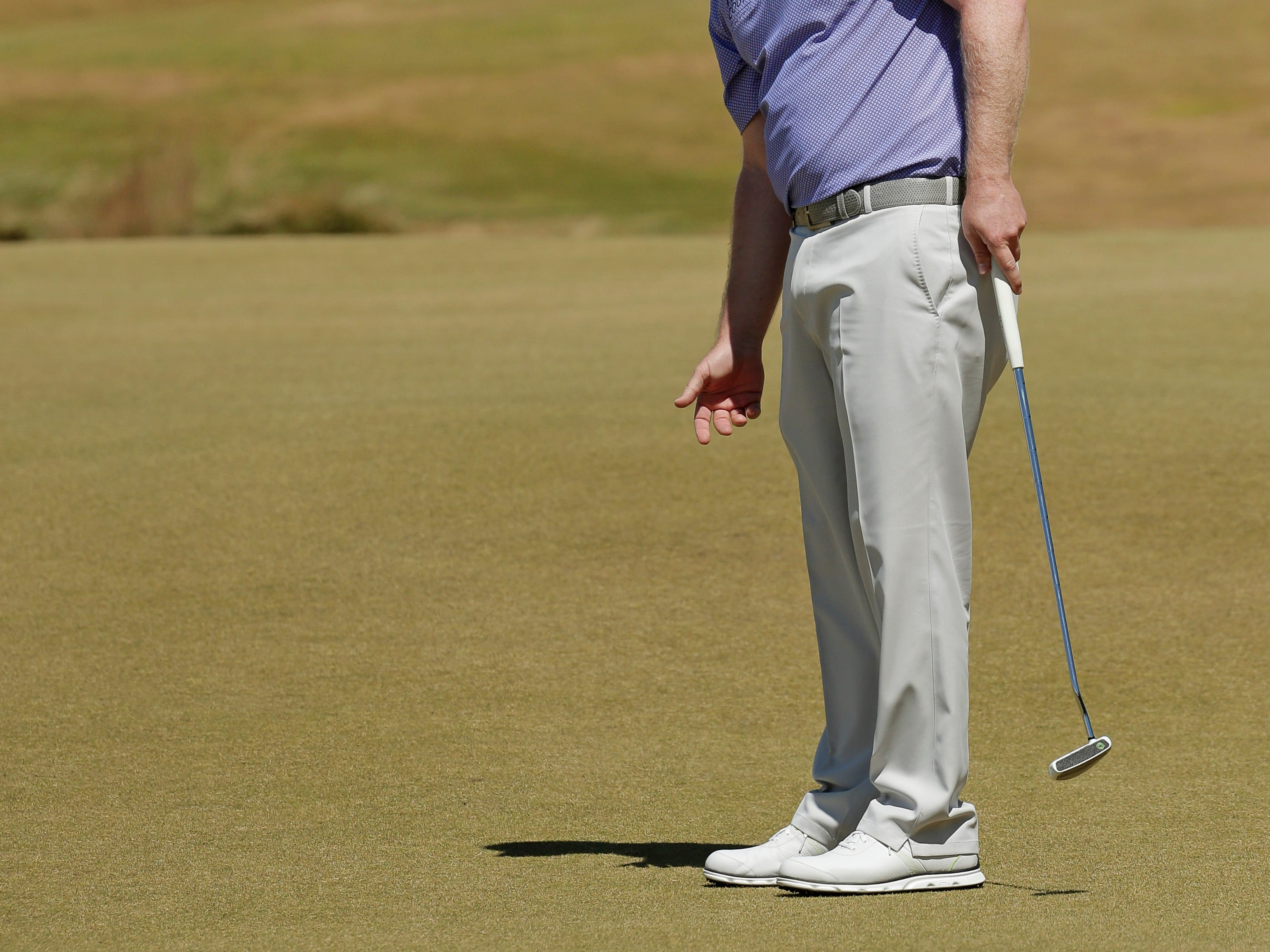 Branden Grace, of South Africa, reacts to his putt on the 13th hole during the second round of the U.S. Open golf tournament at Chambers Bay on Friday, June 19, 2015 in University Place, Wash. (AP Photo/Charlie Riedel)