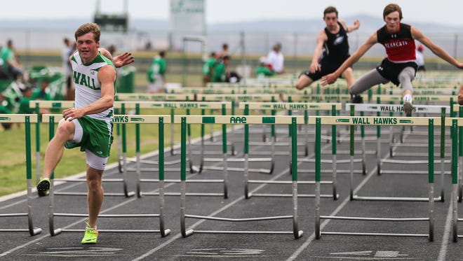 Wall's Drake Holifield races in the 100 meter hurdles the District 4-3A Track and Field Championships Friday, April 6, 2018, at Wall High School.