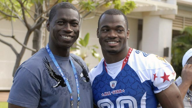Adrian Peterson and his father, Nelson Peterson, in 2009.