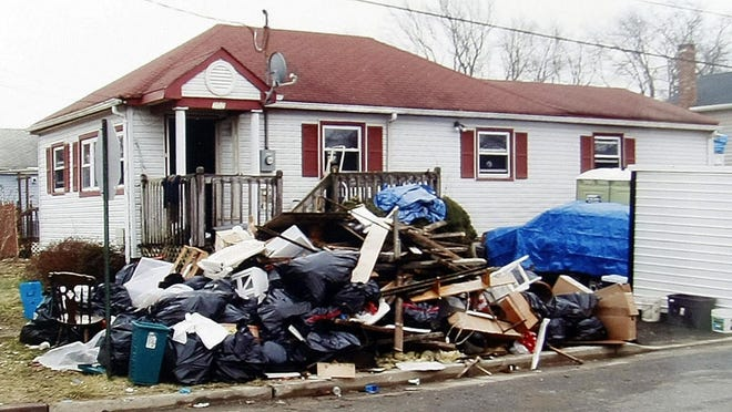 A photo taken in mid-November 2012 shows debris outside a Union Beach home.
