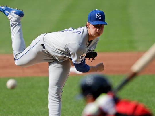 Kansas City Royals starting pitcher Brady Singer delivers to Cleveland Indians Cesar Hernandez in the first inning of a baseball game on Saturday, July 25, 2020 in Cleveland.  (AP Photo / Tony Dejak)