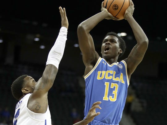 UCLA's Kris Wilkes (13) shoots under pressure from Creighton's Marcus Foster during the first half of an NCAA college basketball game in the Hall of Fame Classic, Monday, Nov. 20, 2017, in Kansas City, Mo. (AP Photo/Charlie Riedel)