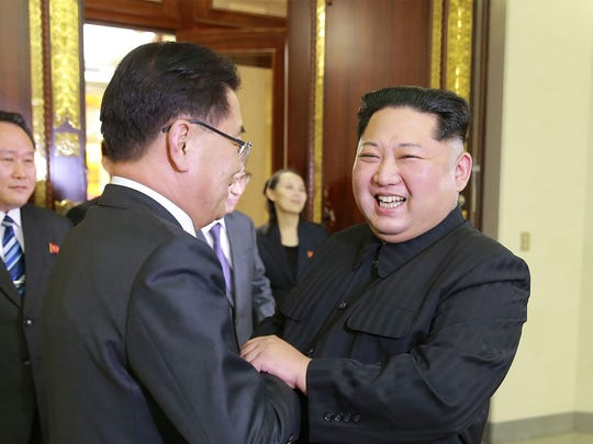 North Korean leader Kim Jong-Un, right shakes hands with South Korean chief delegator Chung Eui-yong, who travelled as envoys of the South's President Moon Jae-in, during their meeting in Pyongyang on Monday