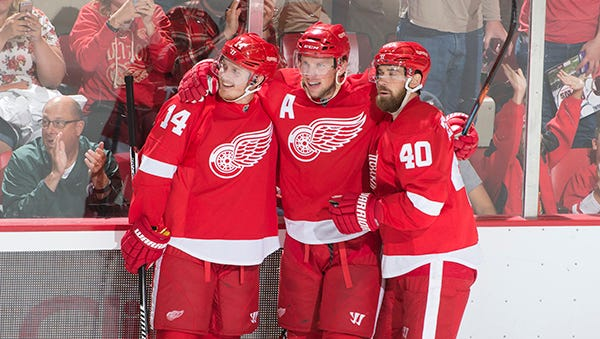 From left, Gustav Nyquist, Justin Abdelkader,             Henrik Zetterberg and the Wings begin their trip Wednesday in Edmonton.
