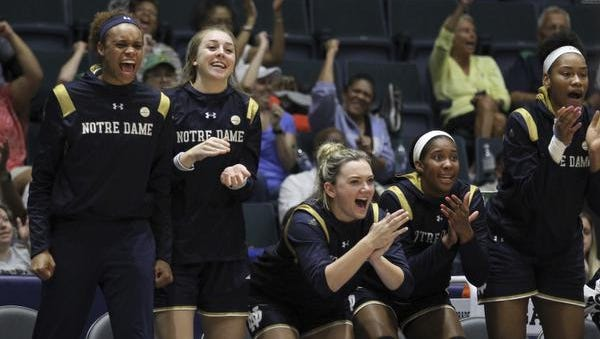Notre Dame players react during the third quarter of their game against South Carolina in the Gulf Coast Showcase championship on Sunday. Notre Dame won 92-85. (AP Photo/Luis M. Alvarez)