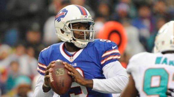 Buffalo Bills quarterback Thad Lewis (9) passes against the Miami Dolphins.