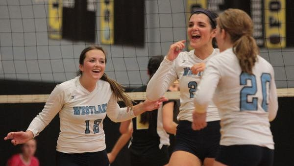 Westlake's Kelly Martin, center, and her teammates celebrate a point against Nanuet during a girls volleyball match at Nanuet High School Monday. Westlake won in three.