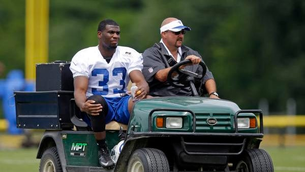 Indianapolis Colts running back Vick Ballard rides off the field on a cart after he was injured during training camp in Anderson, Indiana, on Friday.