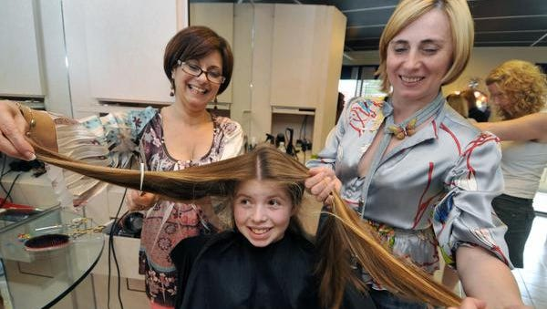 Salon Pasca owners Ann Tasker (left) and Natasha Latina have been holding an annual cut-a-thon at their Wilmington salon since 2008. The donated hair is made into wigs for cancer patients.