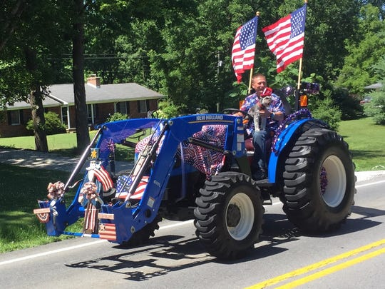 Keith Berry, with his dog riding shotgun, won the tractor