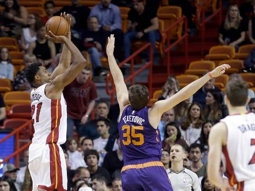 Miami Heat center Hassan Whiteside (21) shoots as Phoenix