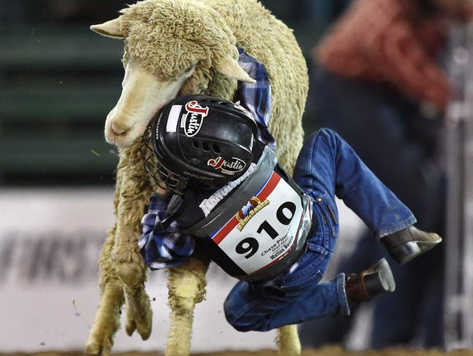 Action photos of the Reno Rodeo Mutton Bustin' event