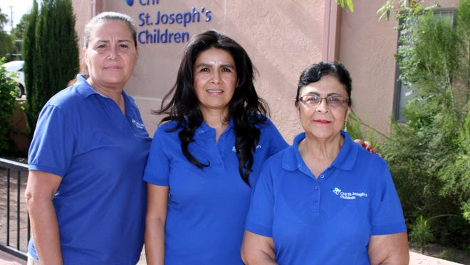 Staff at CHI St. Joseph's Children in Deming have been busy working with expectant mothers and families with infants through home visits and pre- and post-natal education. The staff includes, from left, Cruz Granado, Mari Rubio and Dolores Valdez. The opfficer is located at 201 E. Pine St., corner of East Pine and North Silver Avenue.