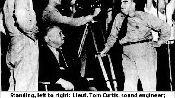 """Standing, left to right: Lieut. Tom Curtis, sound engineer; Jeffrey Lynn; Jay Rescher, head cameraman; George Theirgartner, electrician.  Director Robert J. Flaherty, seated.  (Photo from Robert J. Lewis article about """"York Plan"""" film in The Philadelphia Inquirer, issue of November 22, 1942; page 137.)"""