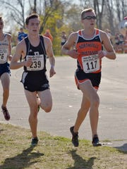 Plymouth junior Ethan Byrnes (left) and Northville's Ben Cracraft are in lockstep during the Division 1 boys cross country meet.