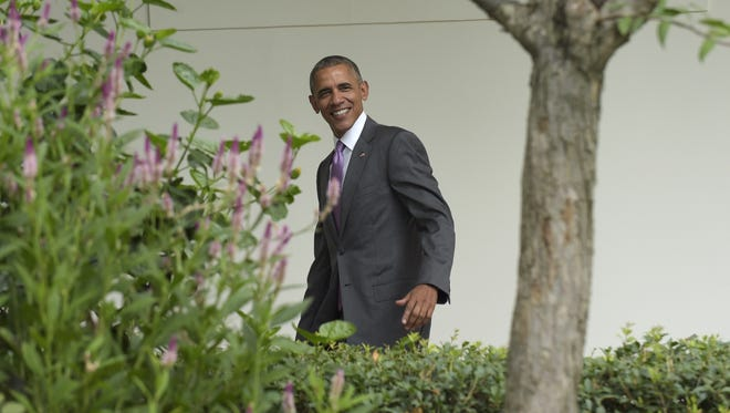 President Barack Obama walks along the Colonnade as he heads to the Oval Office of the White House in Washington, Wednesday, July 27, 2016. Obama's signature health care program is under fire, due to large premium increases. (AP Photo/Susan Walsh)