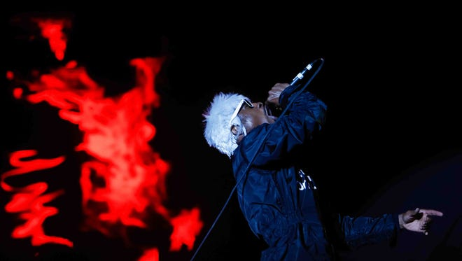 OutKast's André 3000 lights up the Firefly Main Stage Saturday night as thousands roll into The Woodlands on the third day of Firefly Music Festival in Dover.