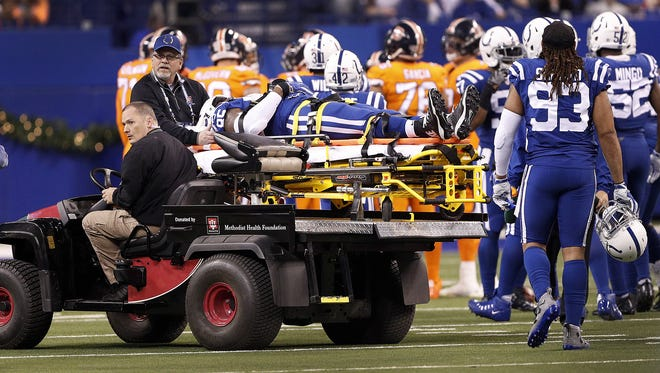 Indianapolis Colts tight end Brandon Williams is tended to by the Colts medical staff in the first half of their game against the Denver Broncos at Lucas Oil Stadium Thursday, Dec 14, 2017.