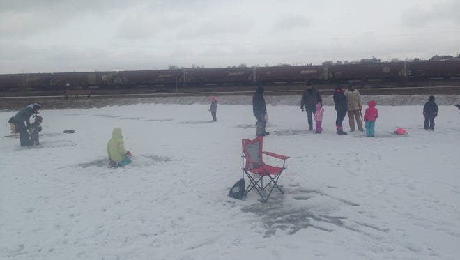 People gather at the Walleyes Unlimited ice fishing day in 2017.