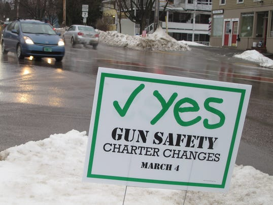 -GunSafetySign.JPG_20140221.jpg