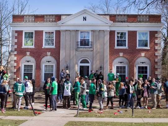As the day warmed up, students celebrated Green Beer Day outside a private residence in downtown Oxford on Campus Ave.
