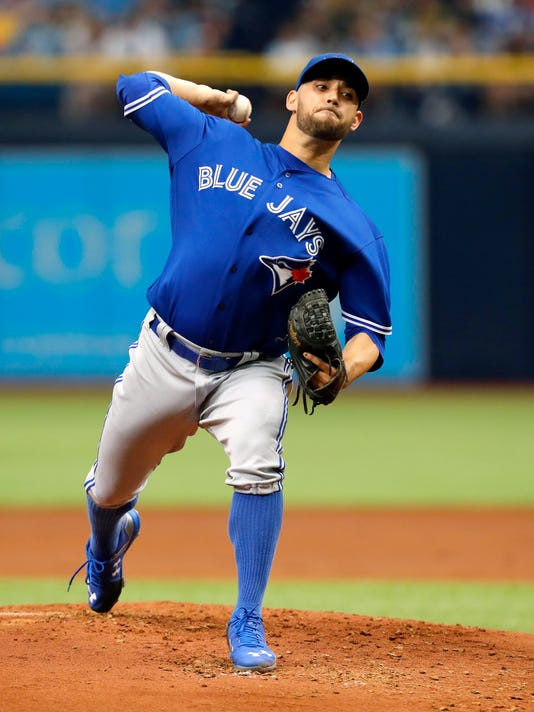 Toronto Blue Jays starting pitcher Marco Estrada throws during the first inning of a baseball game against the Tampa Bay Rays, Sunday, April 9, 2017, in St. Petersburg, Fla. (AP Photo/Mike Carlson)