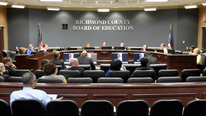 Richmond County Board of Education trustees sit behind the dais. Candidate qualifying for districts 1, 4, 5, 8 and 10 continues through noon Friday for the Nov. 3 general election.