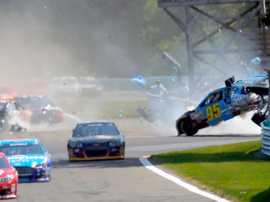 Michael McDowell, driver of the No. 95 Ford, and Ryan Newman, driver of the No. 31 Chevrolet, are involved in an crash during the 2014 Cheez-It 355 at The Glen.