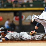Minnesota Twins second baseman Brian Dozier, sliding, has 15 home runs and 23 doubles this season.