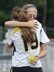 HF-L's Caitlin Muir, facing, hugs teammate Maria Villanti following their loss in the NYSPHSAA Girls Lacrosse Championships Class C final played at SUNY Cortland on Saturday, June 6, 2015. Honeoye Falls-Lima's season ended with an 8-5 loss to Mt. Sinai-XI.