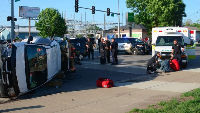 A vehicle flipped on its side after in an injury accident at 10th and Kiwanis on Monday night.