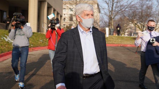 Former Gov. Rick Snyder exits after his video arraignment Thursday at the Genesee County Jail in Flint on new Flint water crisis charges.