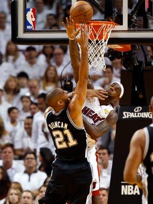 Heat forward LeBron James blocks a dunk by Spurs forward Tim Duncan in last season's NBA Finals.