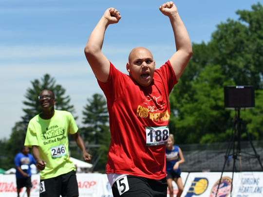 Elkhart Memorial's Julian Williams celebrates after winning his heat of the 400 meter run during the Unified IHSAA track and field state finals at Robert C. Haugh Track and Field complex in Bloomington, Ind. on Saturday, May, 2, 2018.