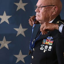 U.S. President Barack Obama (R) presents the Medal of Honor to Army Command Sergeant Major Bennie G. Adkins (L) during an East Room ceremony at the White House September 15, 2014 in Washington, DC.  Then-Sergeant First Class Adkins was awarded with the Medal of Honor for his actions during combat operations at Camp A Shau, Republic of Vietnam, on March 9 through March 12, 1966 while serving as an Intelligence Sergeant assigned to Detachment A-102, 5th Special Forces Group, 1st Special Forces.