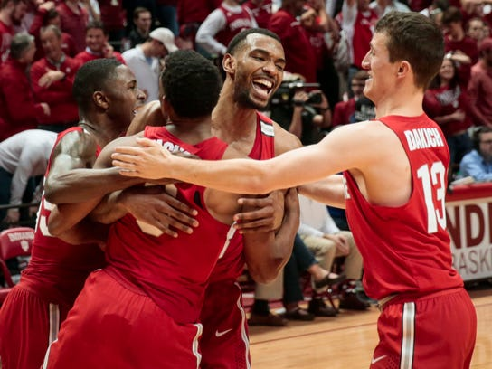 Ohio State forward Keita Bates-Diop, center rear, celebrates with teammates Andrew Dakich, right, Ohio State guard C.J. Jackson, center front, and Kam Williams after defeating Indiana  in double overtime of an NCAA college basketball game in Bloomington, Ind., Friday, Feb. 23, 2018. (AP Photo/AJ Mast)