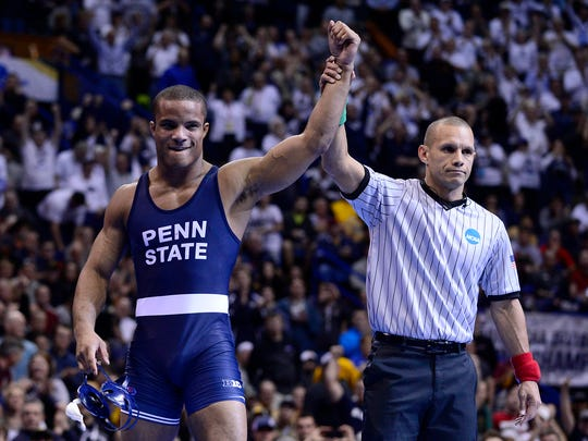 Penn State Nittany Lions wrestler Mark Hall celebrates after defeating Ohio State Buckeyes wrestler Bo Jordan during the 174 weight class finals for the NCAA Division I Wrestling Championships at Scottrade Center.