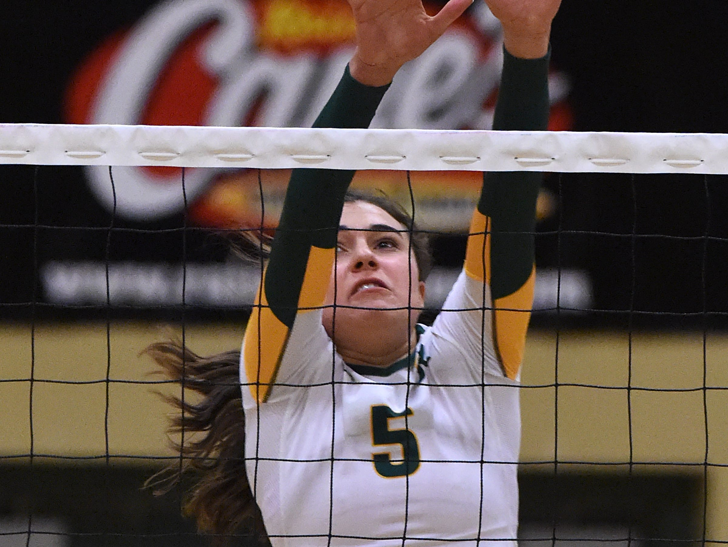 Manogue's Emily Miller goes up for the block against McQueen during Tuesday's game at Manogue High School on Sept. 20, 2016.