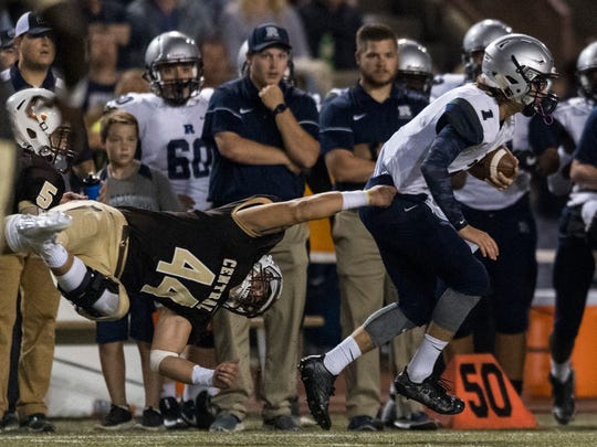CentralÕs Hunter Reason (44) is flipped on his side as he attempts to tackle Reitz Quarterback Eli Wiethop (1) at Central Stadium in Evansville, Ind., on Friday, Sept. 8, 2017. The Panthers defeated the Bears, 28-21.