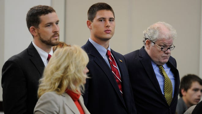 Brandon Vandenburg, middle, stands with attorneys Nathan Colburn, left, and David King during a discussion hearing Wednesday, Oct. 16, 2013, in Criminal Court in Nashville. He and Cory Batey, both charged with rape, were given an Aug. 11 trial date.