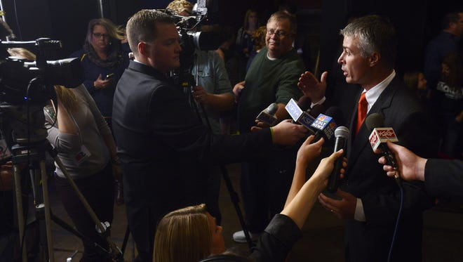 Attorney General Marty Jackley speaks with the media after giving a victory speech Tuesday at a Republican election night party at The District in Sioux Falls, Nov 4, 2014.
