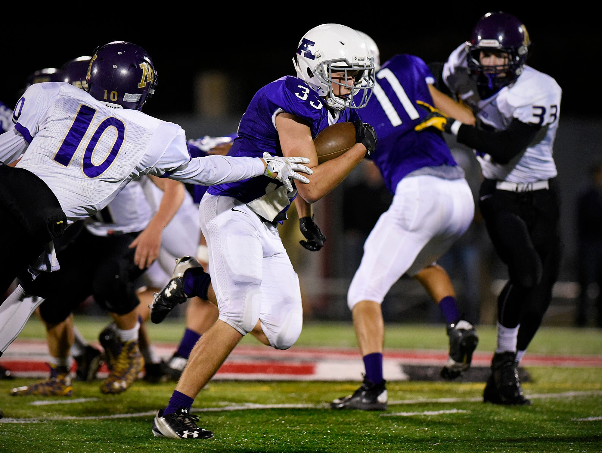 Albany's Kyle Birr breaks away and goes 43 yards to score against Montevideo during the first half Saturday, Oct. 24 at Husky Stadium.