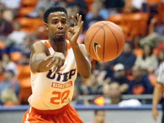 UTEP guard Earvin Morris passes to a teammate during the UTEP basketball team's Orange and White game Saturday in the Don Haskins Center.