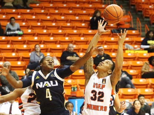 Chrishauna Parker, 32, grabs a loose ball against Northern Arizona's Brittani Lusain, 4, on Tuesday night in the Don Haskins Center.